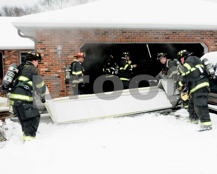 The McHenry Township Fire Protection District (MTFPD) was dispatched on 1/19/2019 at 11:47 AM to 5014 Hickory Way in Johnsburg IL for a structure fire. Emergency response units arrived on the scene within 5 minutes and found a ranch house with smoke coming from the attached garage. Crews aggressively attacked the fire and had it under control within 15 minutes. Seven pieces of MTFPD apparatus responded to the scene consisting of 25 firefighters. In addition, Spring Grove Fire responded to the scene, and Fox Lake Fire provided station coverage during the fire. The Johnsburg Police Department also responded to the scene.<br /> There were no civilian or firefighter injuries. Fire damage was contained to the attached garage. The house and contents sustained smoke damage. The house was habitable and turned back over to the homeowner. The damage is estimated at $25,000. The cause of the fire is accidental