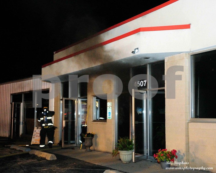 COMMERCIAL BUILDING FIRE 4507 W ELM MCHENRY<br /> THICK BLACK SMOKE POURS OUT OF FORCED OPEN DOORS AS THE FD VENTILATES THE BUILDING AFTER KNOCKING DOWN THE FIRE <br /> COPYRIGHT 2018 WMS PHOTOGRAPHY