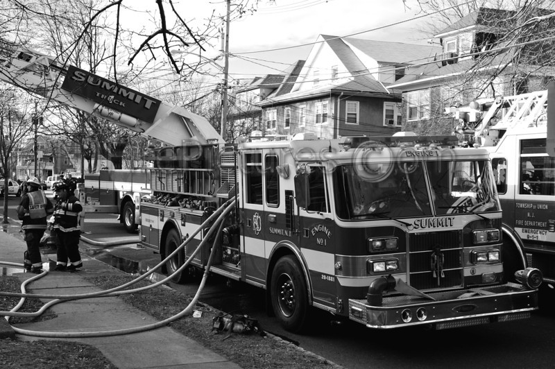 Summit, NJ Engine 1 working at a house fire.