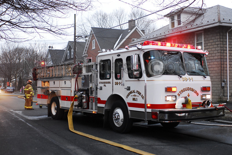 Stroudsburg, PA E-ONE pumper working at an afternoon house fire.