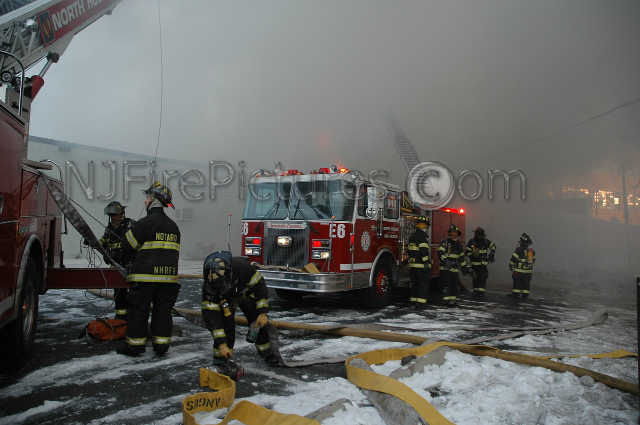 North Hudson Fire Rescue units work at the scene of a 4-Alarm fire in West New York, NJ.