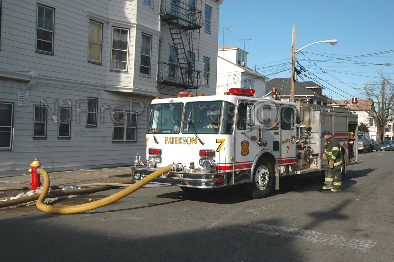 Paterson, NJ Engine 7 using the front suction at a fire scene.