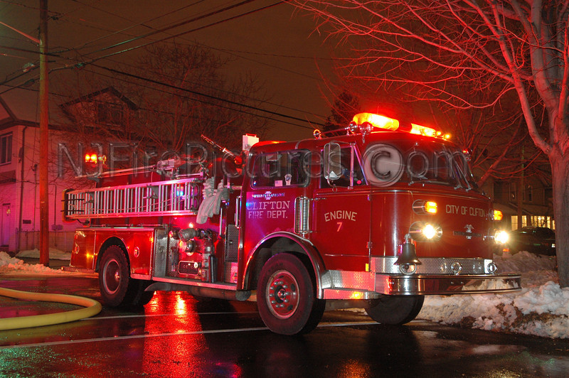 Clifton NJ Engine 7's American LaFrance pumper working a night time fire.