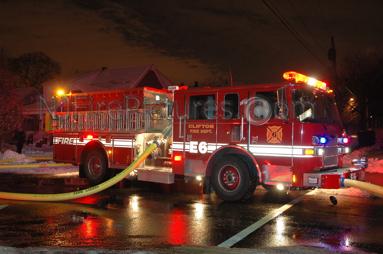 Clifton NJ Engine 6's 2005 Pierce pumping at a fire scene.