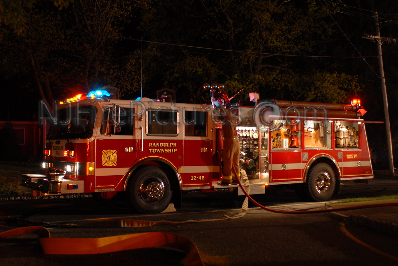 Randolph NJ Engine 32-42's Pierce working a night-time fire scene.