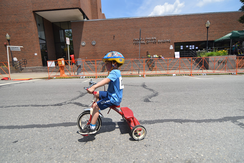 4 year old Lucas Brideau of Leominster rides his trike across the line during the 2018 Longsjo Classic kids race in Fitchburg on Sunday.  SENTINEL & ENTERPRiSE JEFF PORTER