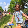 Kid's race winner Yuma Constantine, 4, poses with her bike during the 2018 Longsjo Classic in Fitchburg on Sunday.  SENTINEL & ENTERPRiSE JEFF PORTER