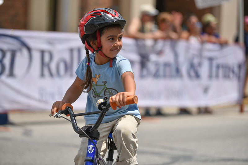 Kid's race winner Yuma Constantine, 4, crosses the line with a smile during the 2018 Longsjo Classic in Fitchburg on Sunday.  SENTINEL & ENTERPRiSE JEFF PORTER