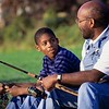 UN14.21 / to replace the photo of the African-American father and son walking and talking / Choice 1 of 13