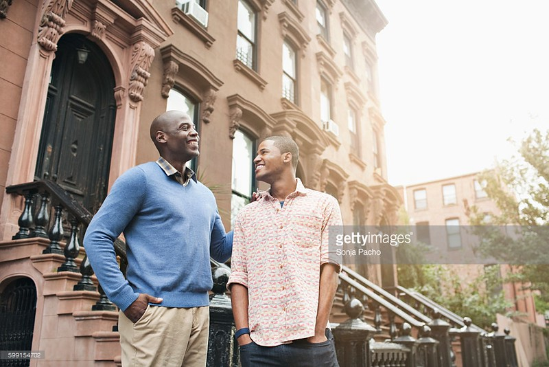 UN14.21 / to replace the photo of the African-American father and son walking and talking / Choice 10 of 13