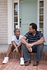 UN14.21 / to replace the photo of the African-American father and son walking and talking / Choice 3 of 13