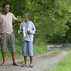 UN14.21 / to replace the photo of the African-American father and son walking and talking / Choice 5 of 13