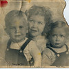 Doug, Connie, Gary in about 1947-8.  Mom reported Gary was not very cooperative and cried greatly, hitting the toy the photographer tried to humor him with.