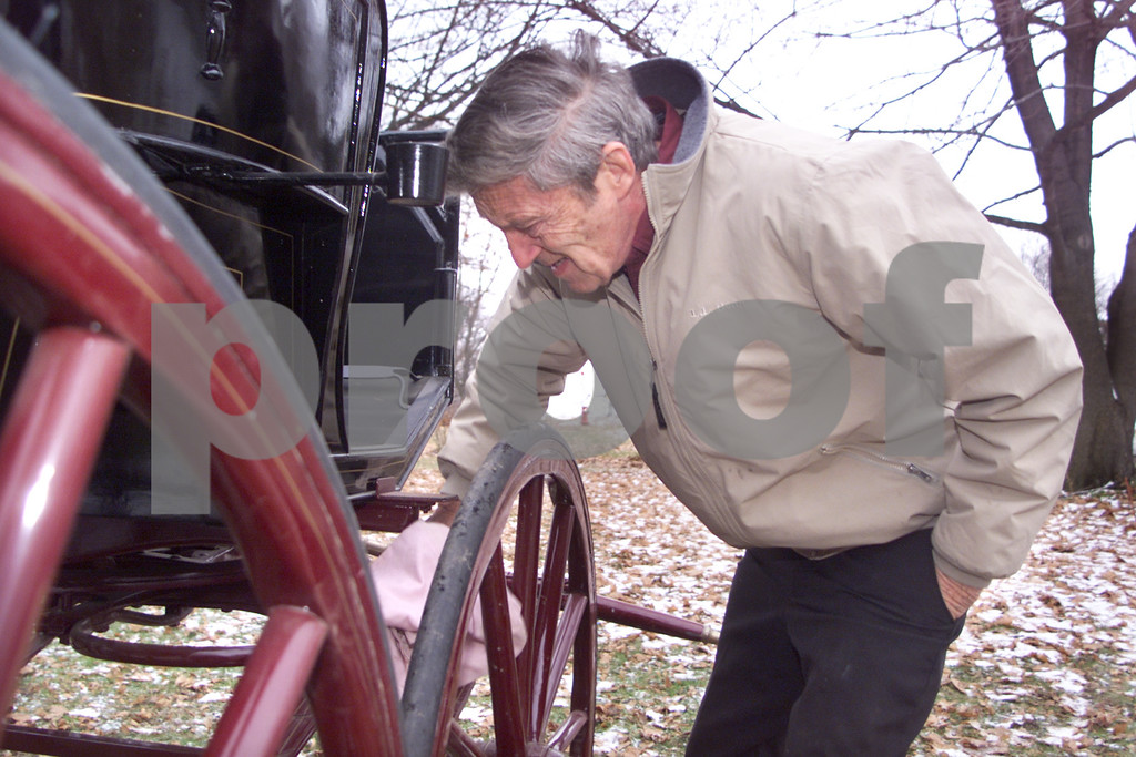Young 1. Robert Young, 64, of Geneva owns 15 carriages. The oldest carriage is from the 1800's. <br /> <br /> Young 2. Robert Young, 64, of Geneva cleans dirt and debris off of his Stan Hope Phaeton carriage. This is one of 15 carriages owned by Young.<br /> <br /> Young 3. Robert Young, 64, of Geneva enters driving competitions in New York State and Canada. He drives with two horses.<br /> 1/1/03 50 plus NOT USED