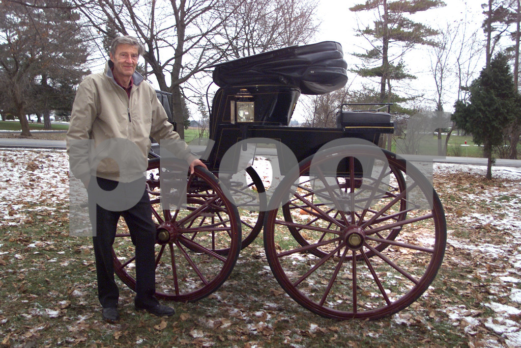 Young 1. Robert Young, 64, of Geneva owns 15 carriages. The oldest carriage is from the 1800's. <br /> <br /> Young 2. Robert Young, 64, of Geneva cleans dirt and debris off of his Stan Hope Phaeton carriage. This is one of 15 carriages owned by Young.<br /> <br /> Young 3. Robert Young, 64, of Geneva enters driving competitions in New York State and Canada. He drives with two horses.<br /> 1/1/03 50 plus
