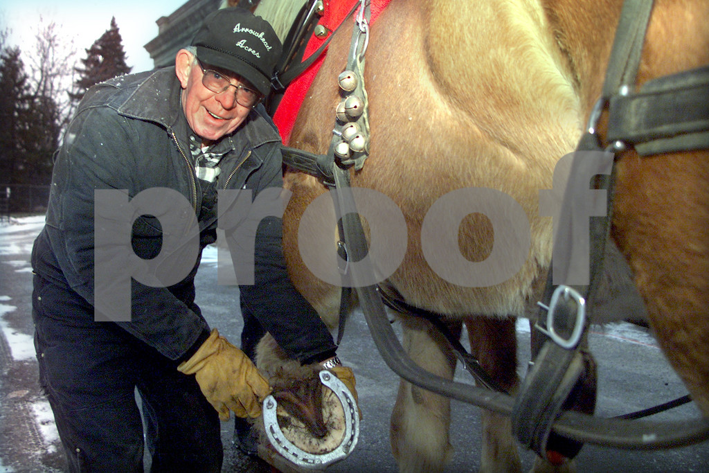 Mack 2.  Ken Mack, 64, check the shoe of one of his Belgian Draft horses have studded shoes so they do not slip on the pavement during winter season.<br /> 1/1/03 50 PLUS