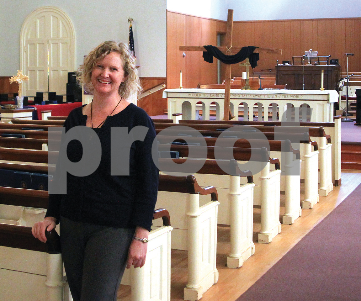 Spencer Tulis / Finger Lakes Times<br /> The Waterloo Presbyterian Church is celebrating its 200th anniversary with a series of events this year. Two former ministers, Rev. John Carlisle and Rev. Nancy Torpey Bidlespacher, have accepted invitations to return for the Sept. 17 celebration. Pictured is current pastor Sarah West who has been there 10 years.