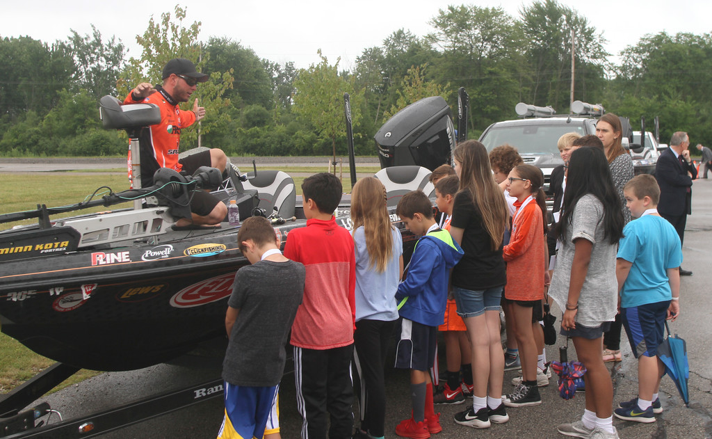 . Cody Kelley shows the boat to the students