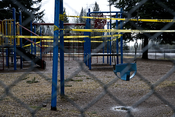 The playground at Chalo School ribboned off with hazard tape, preventing use from children during the stay home order.