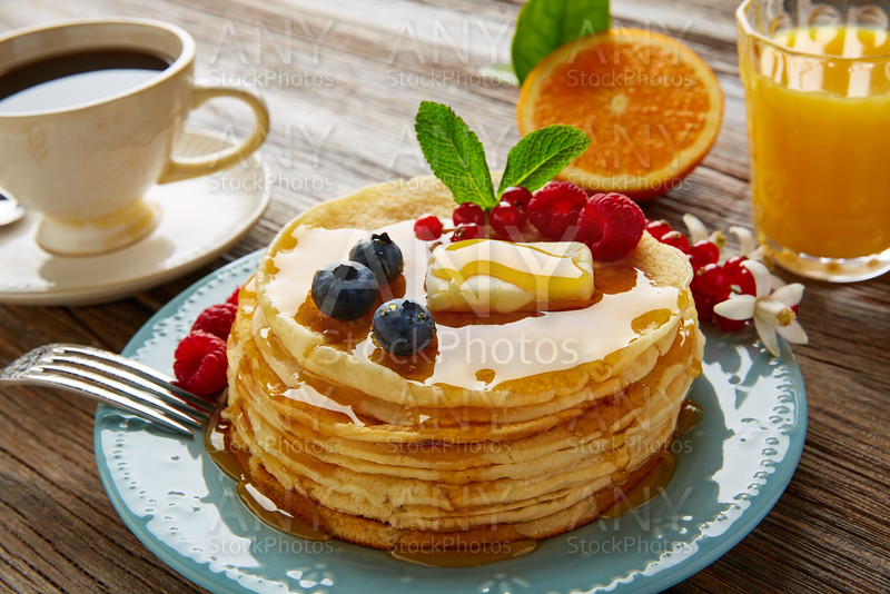 pancakes breakfast syrup coffe and orange juice