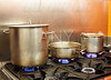 Restaurant pro kitchen with steel pans in fire