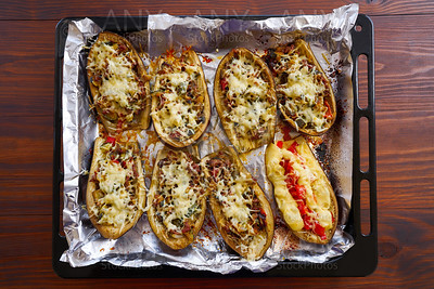 Meat stuffed eggplants recipe on wood