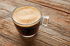 Coffee glass cup on wooden table