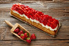 Strawberries puff pastry pie on wood