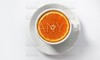 Orange slice in a coffee cup