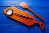 Chef tool wood spatula and table board on blue
