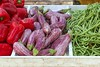 eggplant red pepper green beans on market store