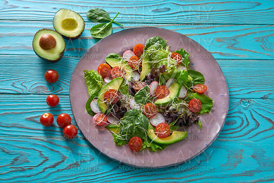 Avocado salad with sprouts tomatoes spinach