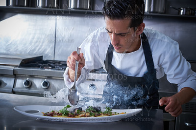 Chef preparing octopus in kitchen with smoke