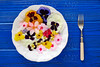 Edible flowers salad in a plate