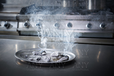 charcoal  ashes smoke in a stainless kitchen