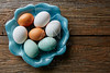 Colorful eggs in white brown and blue colors