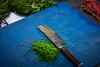 Cutting chives in restaurant kitchen