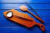 Chef tools tweezers and spatula on wood