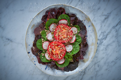 Tomato salad with seeds radish spinach lettuce