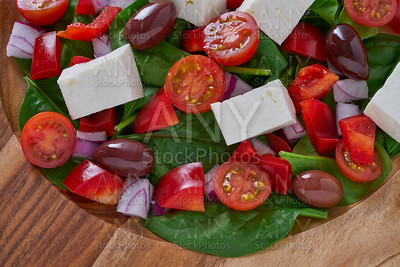 Cheese salad with tomatoes spinach and olives