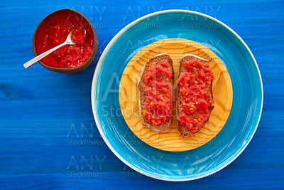 Bread toasted slices with grated tomato