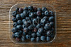 Blueberries fruits on a wooden board table
