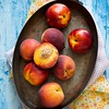 Peaches and nectarines in vintage pot
