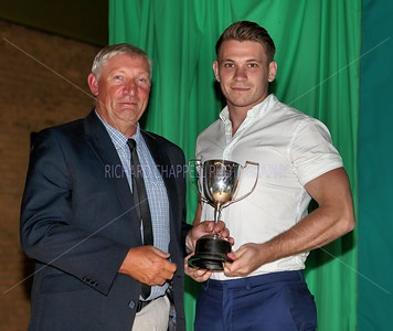 Kent Kauppinen gets Supporters Player of the Year from Mark Woodlridge