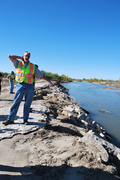 "City Engineer Brad Curtis stands along the bank of the South Platte River and points out the previous fortifications done to the bank, which in many places survived the flood of water into Riverside Park. ""This is what we're proposing with the Army Corps of Engineers and FEMA, because you can see the bank held here along the river,"" Curtis said. (Jenni Grubbs/Fort Morgan Times)"