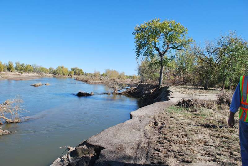 The flood caused instability in this trail that runs along the South Platte River in Riverside Park, and the unstable ground that used to be the improved trail, shown here Wednesday, Oct. 23, 2013,  continues to fall down into the river. (Jenni Grubbs/Fort Morgan Times)
