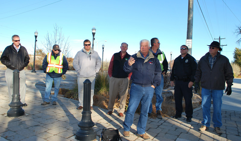 "Fort Morgan Mayor Terry McAlister, in front, speaks at the reopening ceremony Monday, Nov. 4, 2013, at Riverside Park. ""I'm amazed what this park looks like now,"" McAlister said, inviting city residents to come check it out. Pictured, from left, are: City Clerk/Public Information Officer John Brennan, Parks Superintendent Doak Duke, Water Resources/Utilities Director Brent Nation, City Manager Jeff Wells, McAlister, City Engineer Brad Curtis, Interim Fort Morgan Police Chief Darin Sagel and City Councilman Scott Bryan.  (Jenni Grubbs/Fort Morgan Times)"