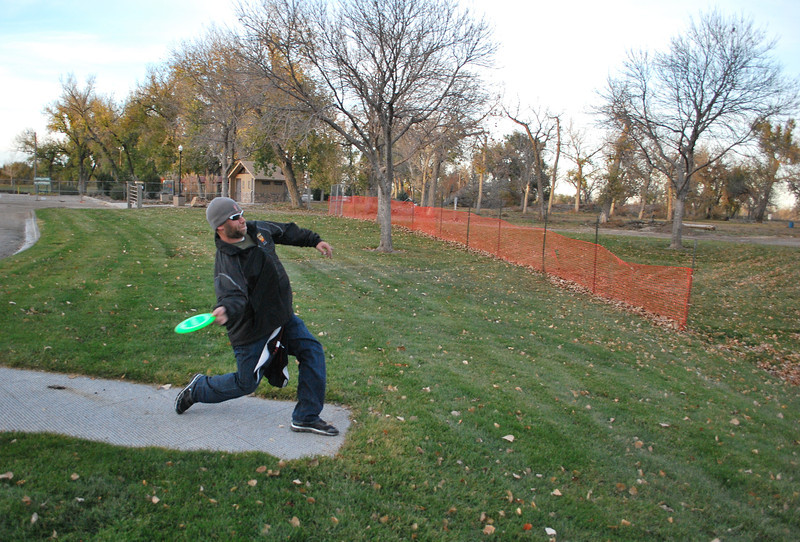 Erik Stark, president of the Morgan County Disc Golf Association Chainbusters, gets ready to release a disc during his first round Monday, Nov. 4, 2013, at the newly reopened course at Riverside Park. At least nine holes are open again, allowing enthusiasts and amateurs to get in a round. (Jenni Grubbs/Fort Morgan Times)