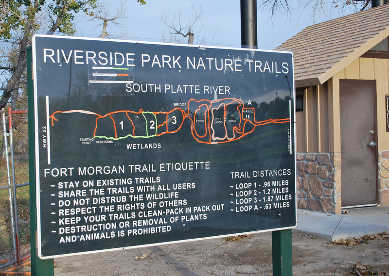 This sign by the bathrooms at Riverside Park shows the park's trail system and what is open and what remains closed. The Loop 2 path marked in green is open again, and it offers about a 1.2-mile round trip for walkers and joggers. (Jenni Grubbs/Fort Morgan Times)
