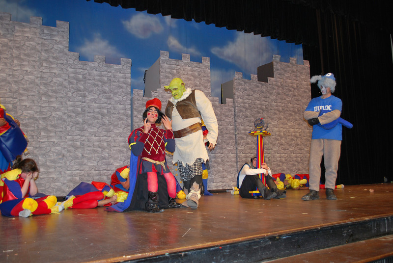 "Lord Farquaad (Travis Freeman) tasks Shrek (Matthew Hofman) and Donkey (Kenny Thompson) to rescue Princess Fiona during Fort Morgan High School's production of ""Shrek the Musical,"" on stage in the Glenn Miller Auditorium later this week. (Jenni Grubbs/Fort Morgan Times)"